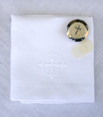 corporal linen with communion wafers and embroidered crossaltar linens