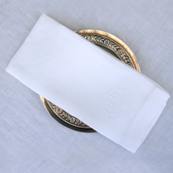 baptismal towel placed on gold colored dish altar linens